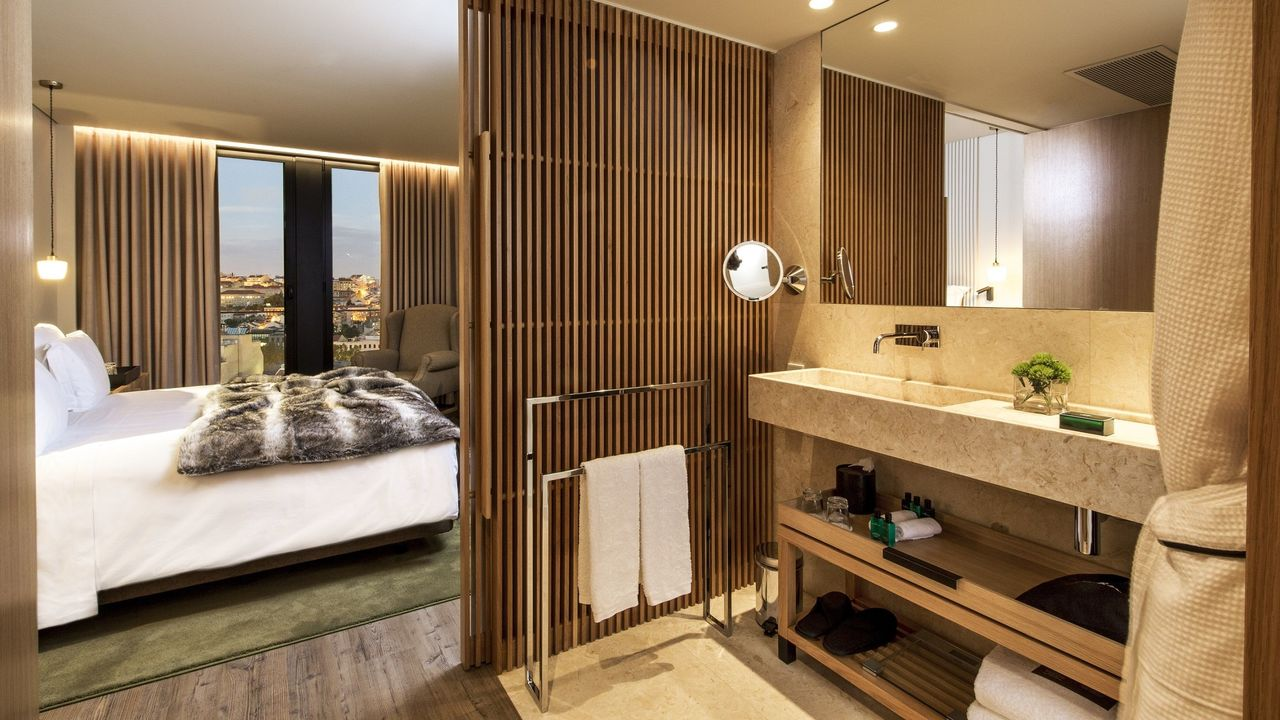 Boutique hotels in LIsbon Memmo Principe real washroom and bedroom with city view