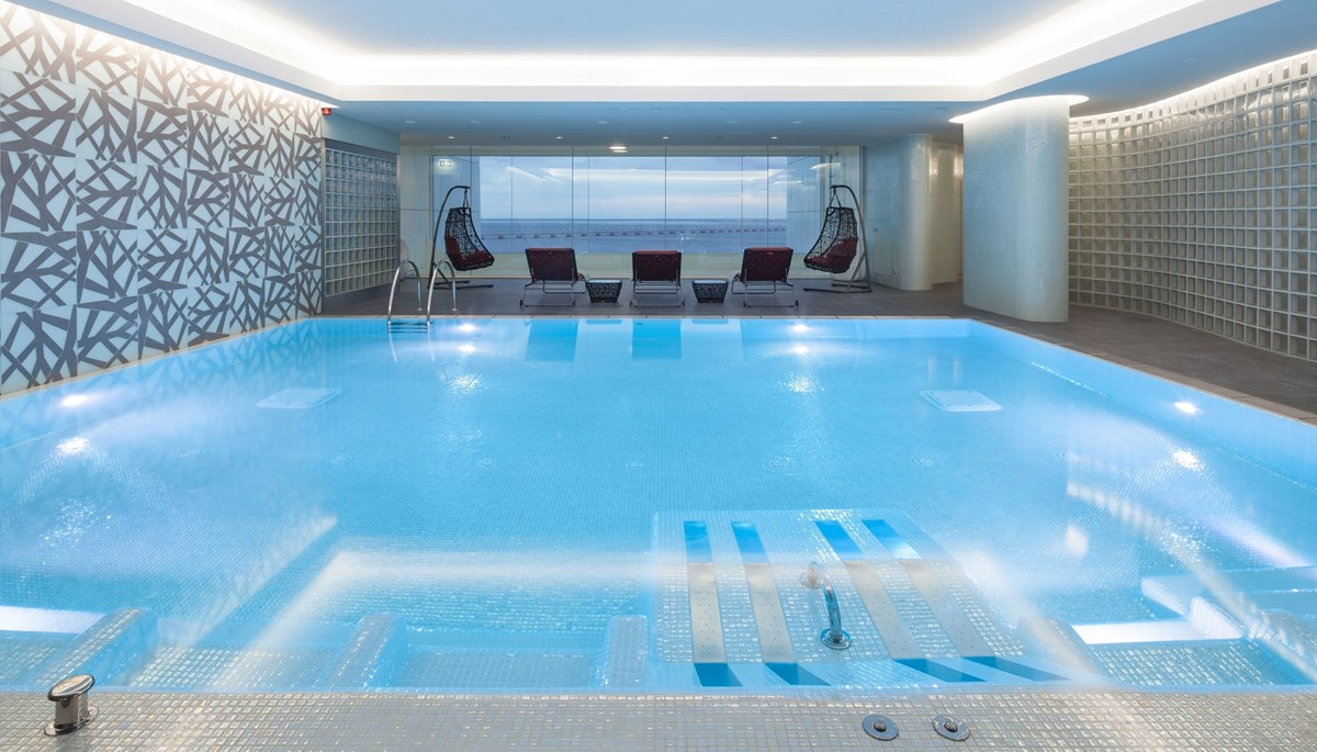 the Sayanna Wellness Spa, a stunning space offering panoramic river views from its 23rd floor setting