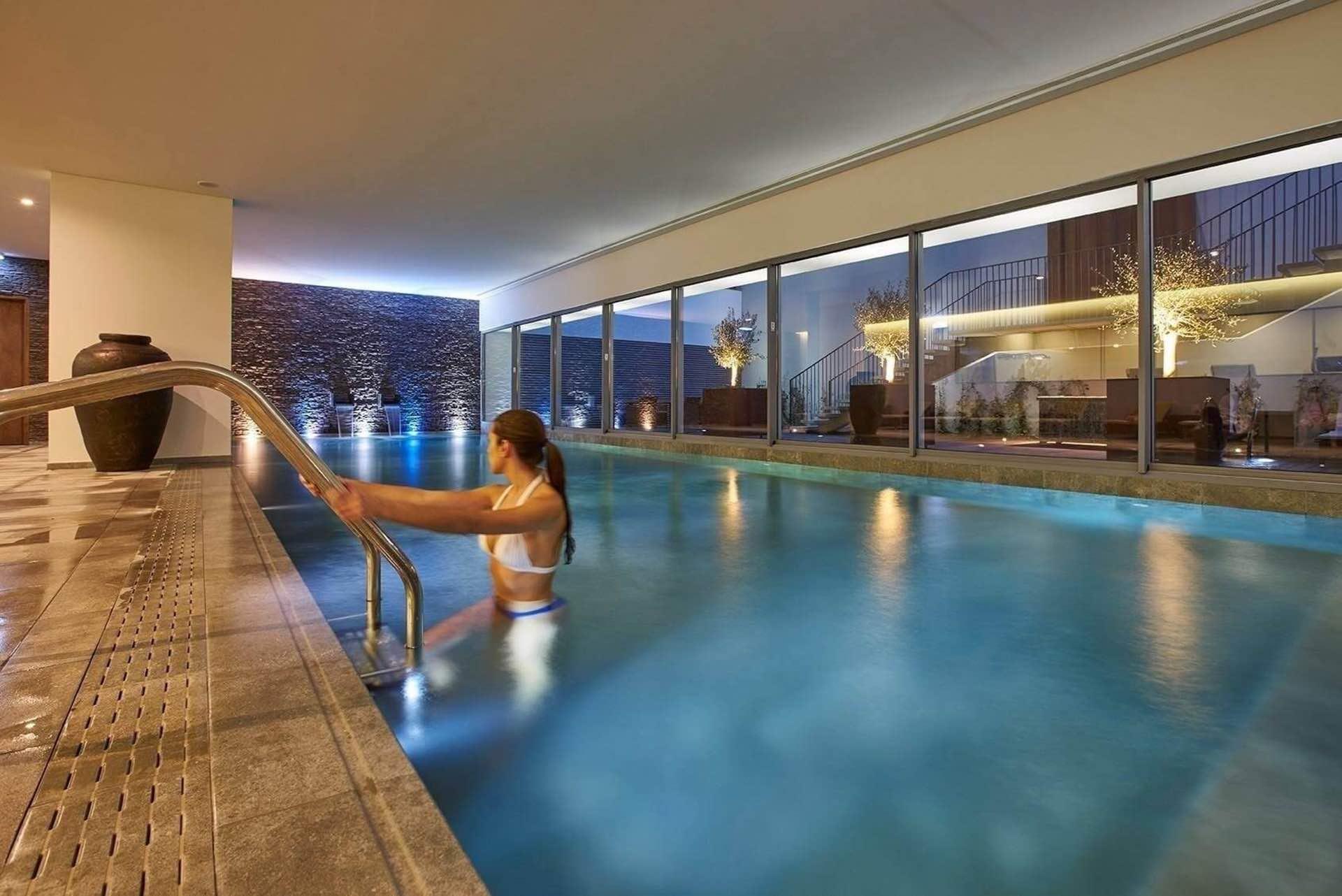 PortoBay Liberdade swimming pool with woman exiting pool
